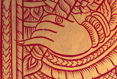 Hand red and gold painting. On the temple wooden door Royalty Free Stock Images