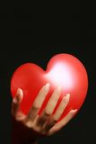 Hand with red heart Royalty Free Stock Image