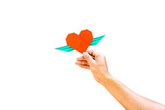 Hand with red heart shape paper Stock Images