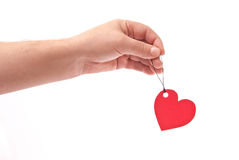 Hand with red heart tag Stock Photos