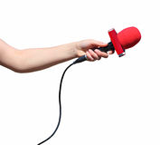 Hand with red microphone isolated Stock Photography