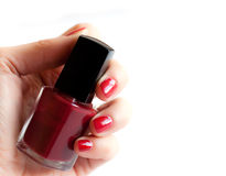 Hand with red nail polish Royalty Free Stock Image