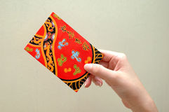 Hand with red packet. Chinese red packet for good luck, blessing and love Royalty Free Stock Images