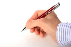 Hand with red pen. stock images