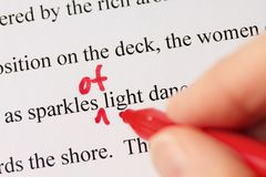 Hand with Red Pen Proofreading Text Closeup Stock Image