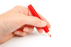 Hand with red pencil Stock Images