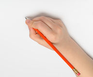 Hand with red pencil Stock Photography