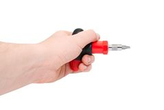 Hand with red screwdriver. Isolated on a white background Stock Photos