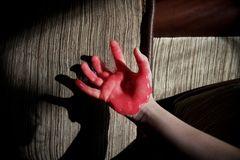Hand in red slime Royalty Free Stock Image