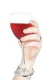 Hand with red wine glass Royalty Free Stock Image