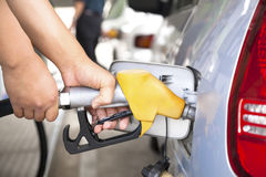 Hand refilling the car with fuel Stock Images