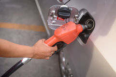 Hand refilling the car with fuel Royalty Free Stock Photo