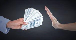 Hand refusing money against navy chalkboard Royalty Free Stock Photo