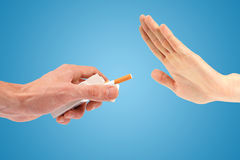 Hand reject a cigarette offer Royalty Free Stock Photo