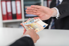 Hand rejecting an offer of money Stock Photos