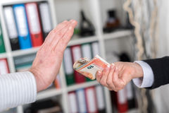 Hand rejecting an offer of money Stock Photography