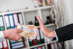 Hand rejecting an offer of money Royalty Free Stock Photography