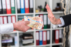 Hand rejecting an offer of money Royalty Free Stock Image