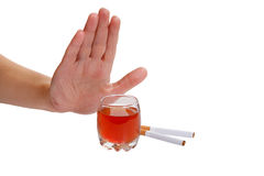 Hand rejects cigarette and alcohol. Stop smoking a. The hand rejects cigarette and alcohol. Stop smoking and drinking Royalty Free Stock Photography