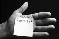 Hand Remember. A Hand with the word Remember printed on a card Royalty Free Stock Image