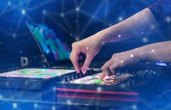 Hand mixing music on midi controller with connectivity concept Stock Photos