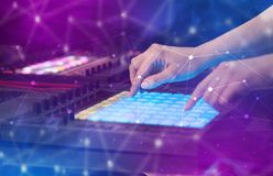 Hand mixing music on midi controller with connectivity concept. Hand remixing music on midi controller with colorful connectivity conceptn royalty free stock photo