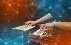 Hand mixing music on midi controller with connectivity concept. Hand remixing music on midi controller with colorful connectivity conceptn royalty free stock image