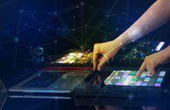 Hand mixing music on midi controller with play music and multimedia concept. Hand remixing music on midi controller with play music and multimedia  conceptn royalty free stock image