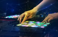 Hand mixing music on midi controller with play music and multimedia concept. Hand remixing music on midi controller with play music and multimedia  conceptn stock photo