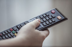 Hand with remote Stock Image