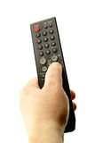 Hand with remote control Royalty Free Stock Images