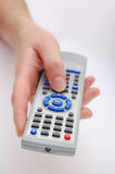 Hand with remote control Stock Images