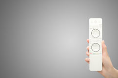 Hand with remote control. Digital, dvd, human royalty free stock photo
