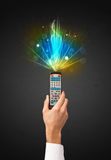 Hand with remote control and explosive signal Stock Photos