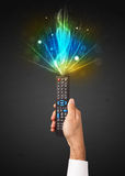 Hand with remote control and explosive signal Royalty Free Stock Photo