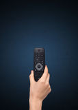 Hand with remote control Stock Photos