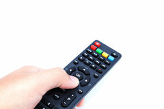 Hand with remote control. Hand holding TV remote control on white background Stock Images