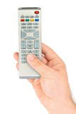 Hand with remote control Stock Image