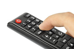 Hand and remote control royalty free stock images