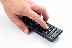 Hand with remote control Royalty Free Stock Photo