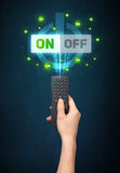 Hand with remote control and on-off signals Stock Images