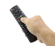 Hand with remote control smart TV Royalty Free Stock Photos