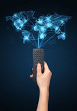 Hand with remote control, social media concept Stock Image