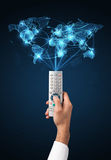Hand with remote control, social media concept Royalty Free Stock Image