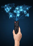 Hand with remote control, social media concept Stock Photo
