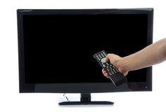 Hand with remote control turning on led tv Stock Images