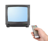 Hand with remote control and tv Royalty Free Stock Photography