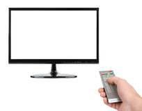 Hand with remote control and tv. Isolated on white background Stock Photos
