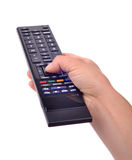 Hand with remote control on white Royalty Free Stock Photos