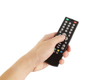 Hand with remote control on white background Royalty Free Stock Photography